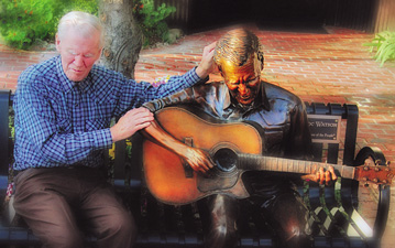 Photo of Doc Watson sitting on the bench and statue of him in Boone, NC.
