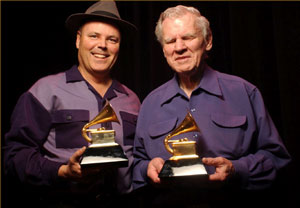 Photo of David Holt and Doc Watson receiving their Grammy award for  Best Traditional Folk Music Recording of 2002.