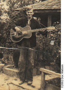 Photo of Doc Watson at age 16 with one of his first guitars.